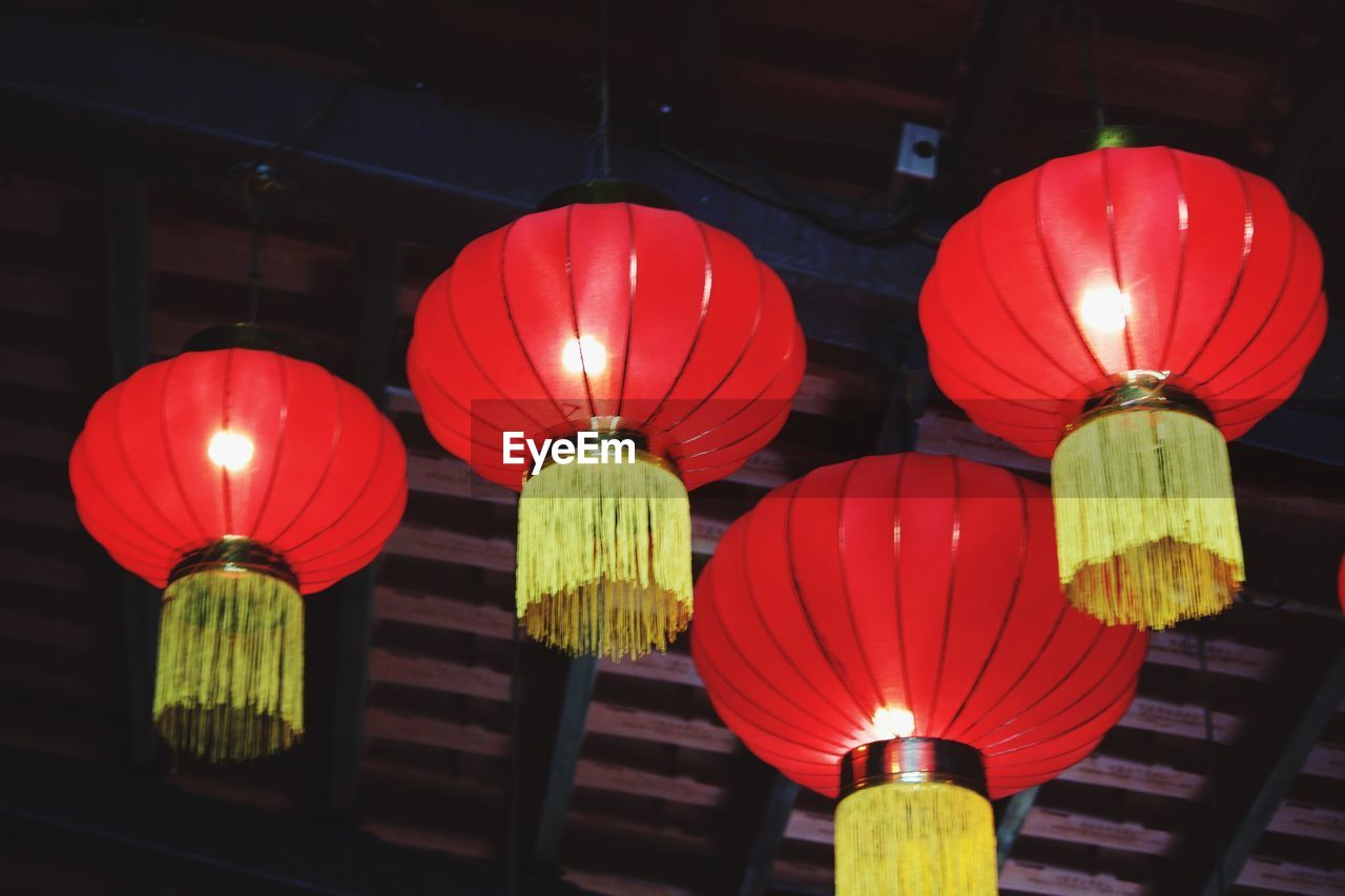 lighting equipment, lantern, illuminated, chinese lantern, low angle view, red, no people, hanging, night, decoration, glowing, indoors, in a row, celebration, built structure, repetition, electricity, chinese lantern festival, ceiling, paper lantern, chinese new year