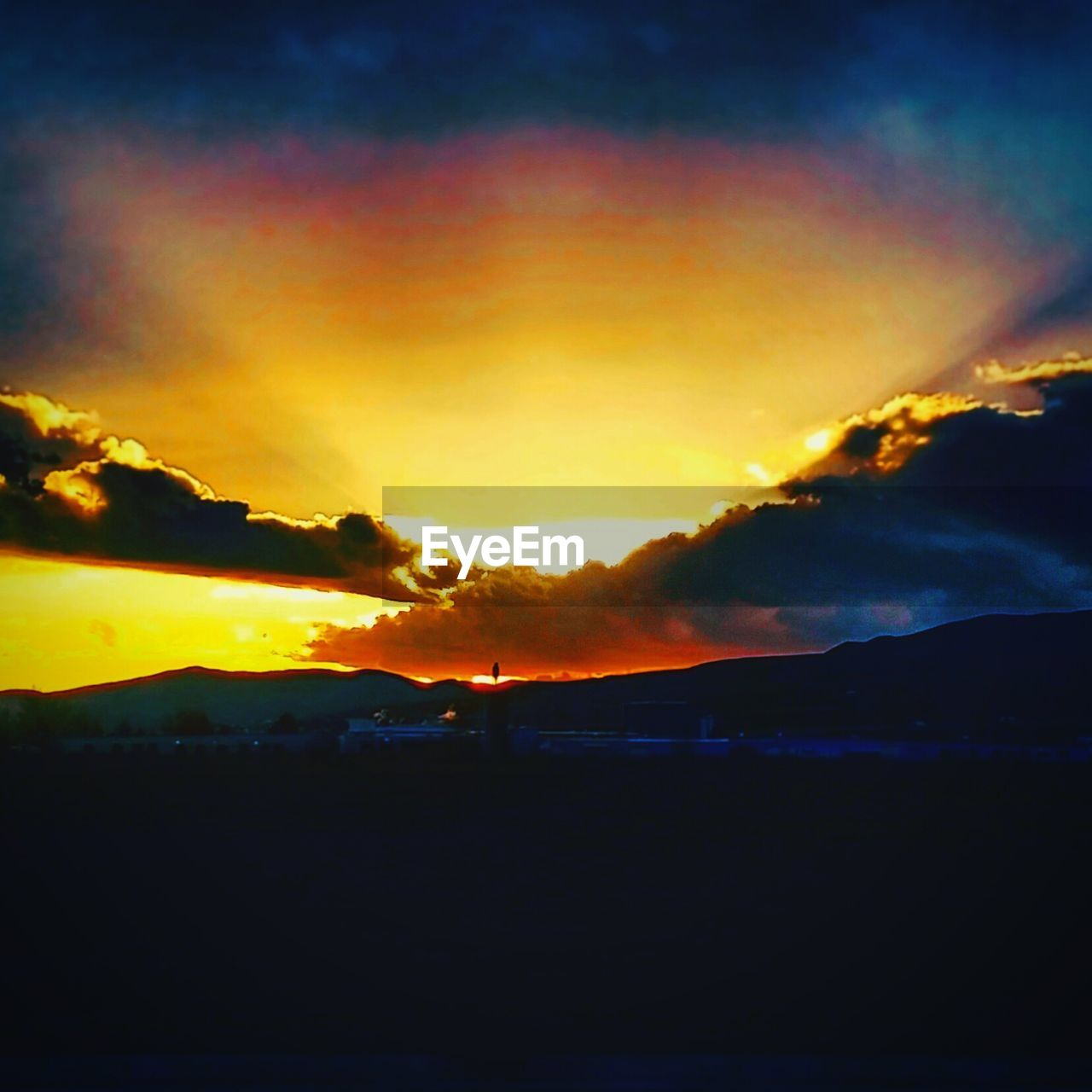 sunset, silhouette, beauty in nature, scenics, nature, sky, orange color, tranquility, dramatic sky, tranquil scene, mountain, no people, outdoors, cloud - sky, landscape, day
