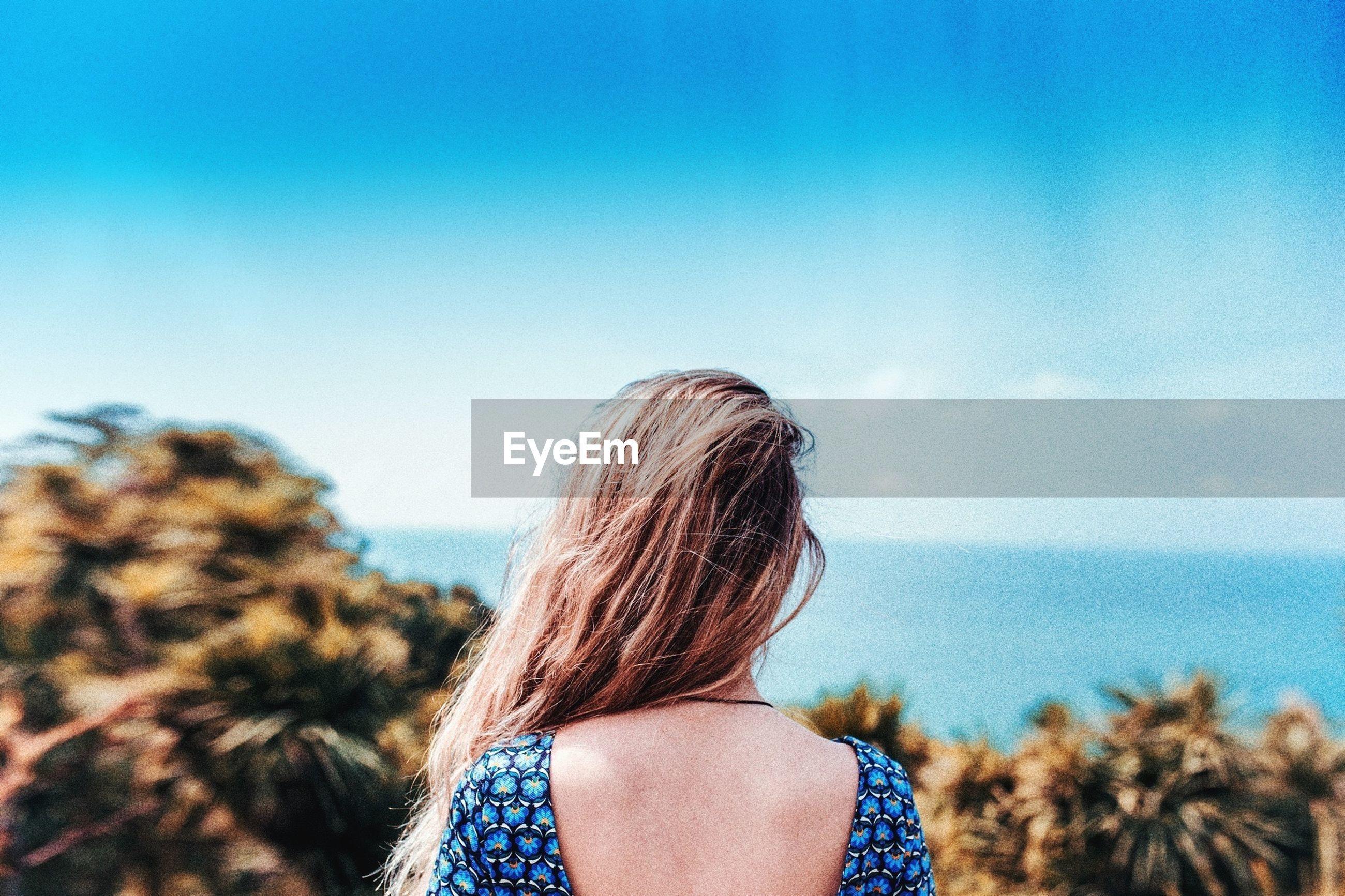 Rear view of woman looking at horizon