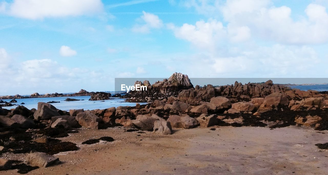 rock, sky, sea, cloud - sky, rock - object, water, solid, beach, land, beauty in nature, day, nature, scenics - nature, rock formation, tranquility, no people, tranquil scene, non-urban scene, outdoors, rocky coastline, eroded