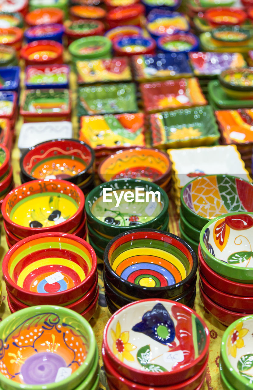 multi colored, large group of objects, abundance, arrangement, indoors, no people, still life, choice, backgrounds, in a row, retail, full frame, high angle view, variation, close-up, for sale, collection, selective focus, market, art and craft, order, retail display