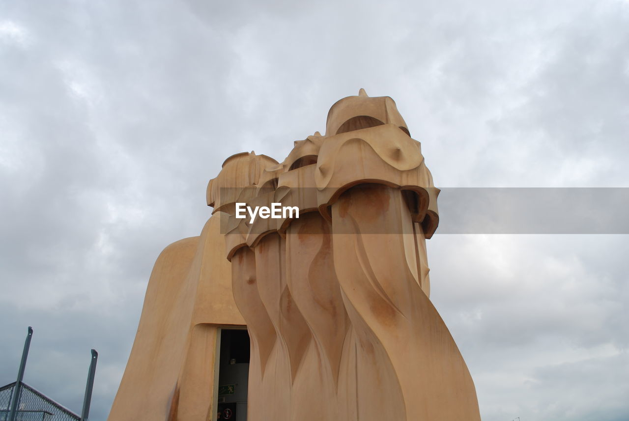 statue, sculpture, cloud - sky, low angle view, sky, human representation, art and craft, no people, day, outdoors, architecture
