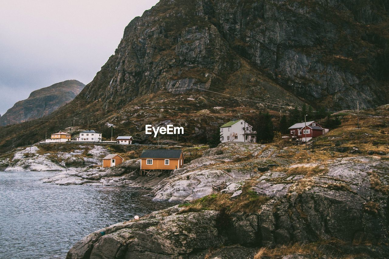 Houses On Mountain By Sea