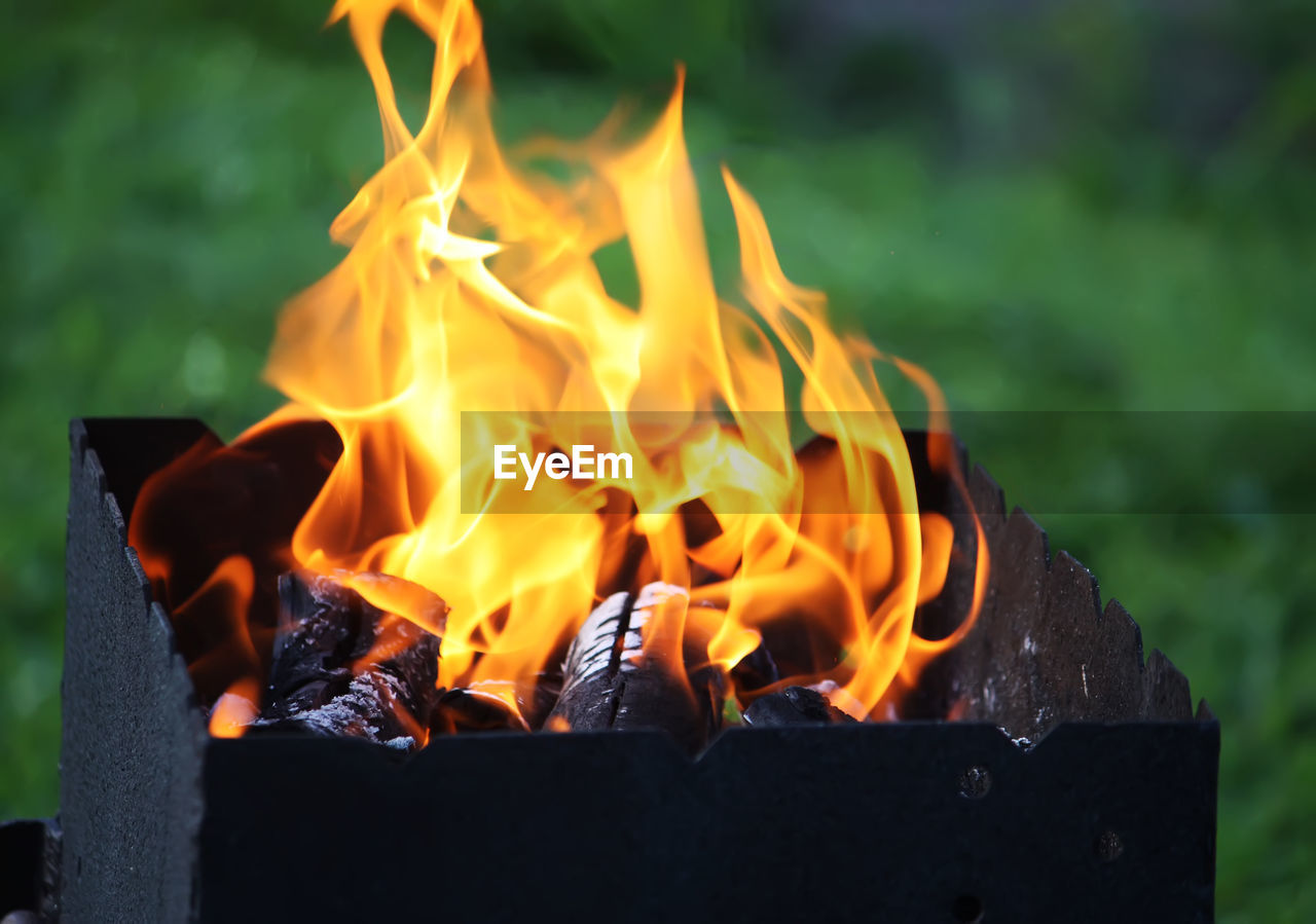burning, heat - temperature, flame, fire, fire - natural phenomenon, orange color, nature, wood - material, glowing, motion, no people, close-up, wood, fireplace, long exposure, fire pit, outdoors, focus on foreground, log, day