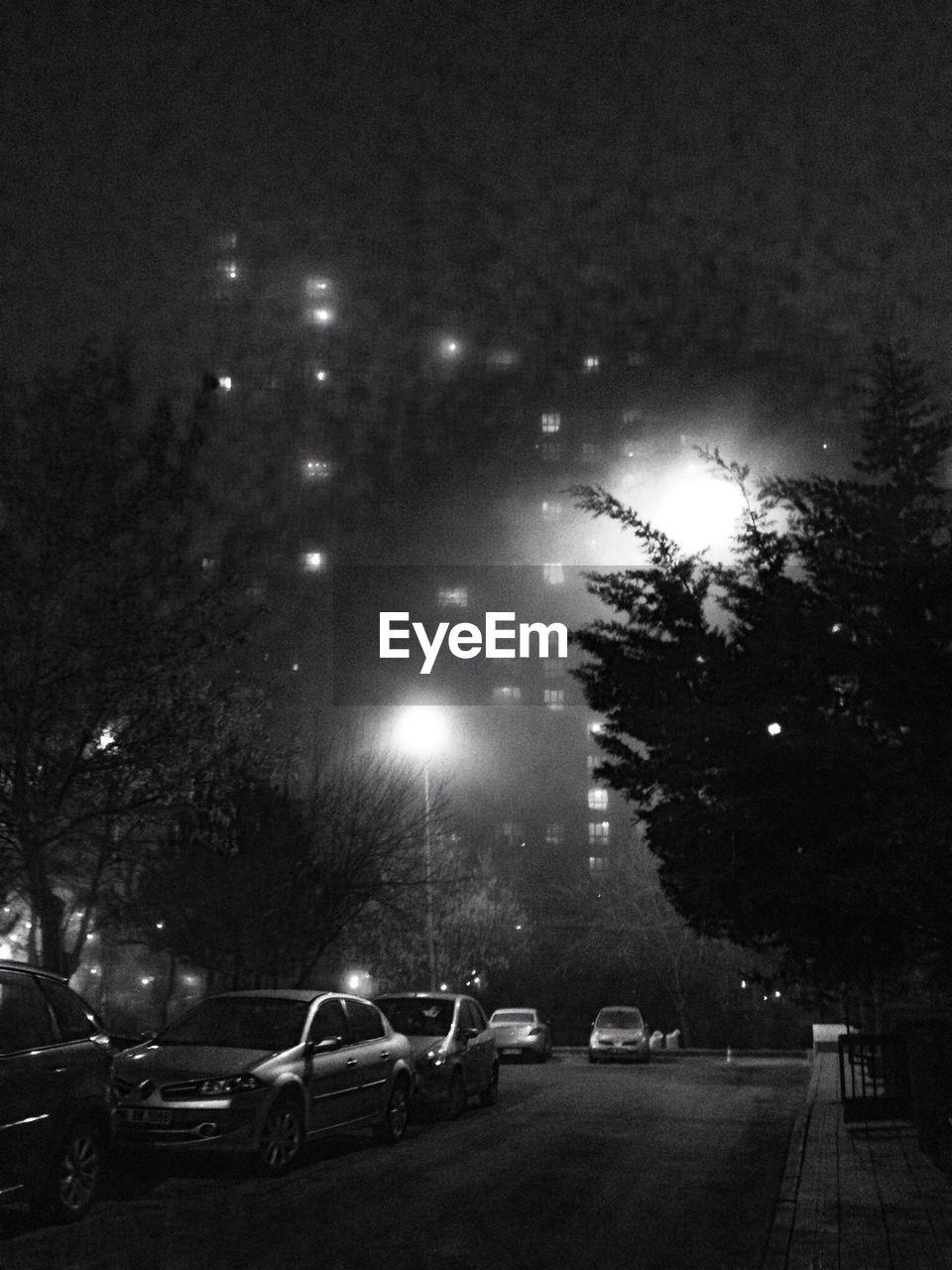 night, illuminated, car, tree, land vehicle, transportation, street light, outdoors, sky, no people, city