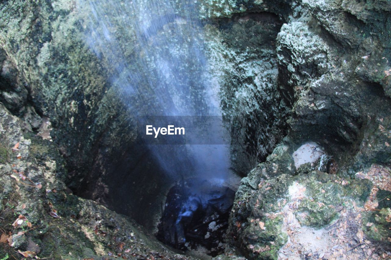 rock - object, geology, rock formation, physical geography, nature, cave, no people, outdoors, day, beauty in nature, waterfall, water, power in nature, hot spring, close-up, satellite view