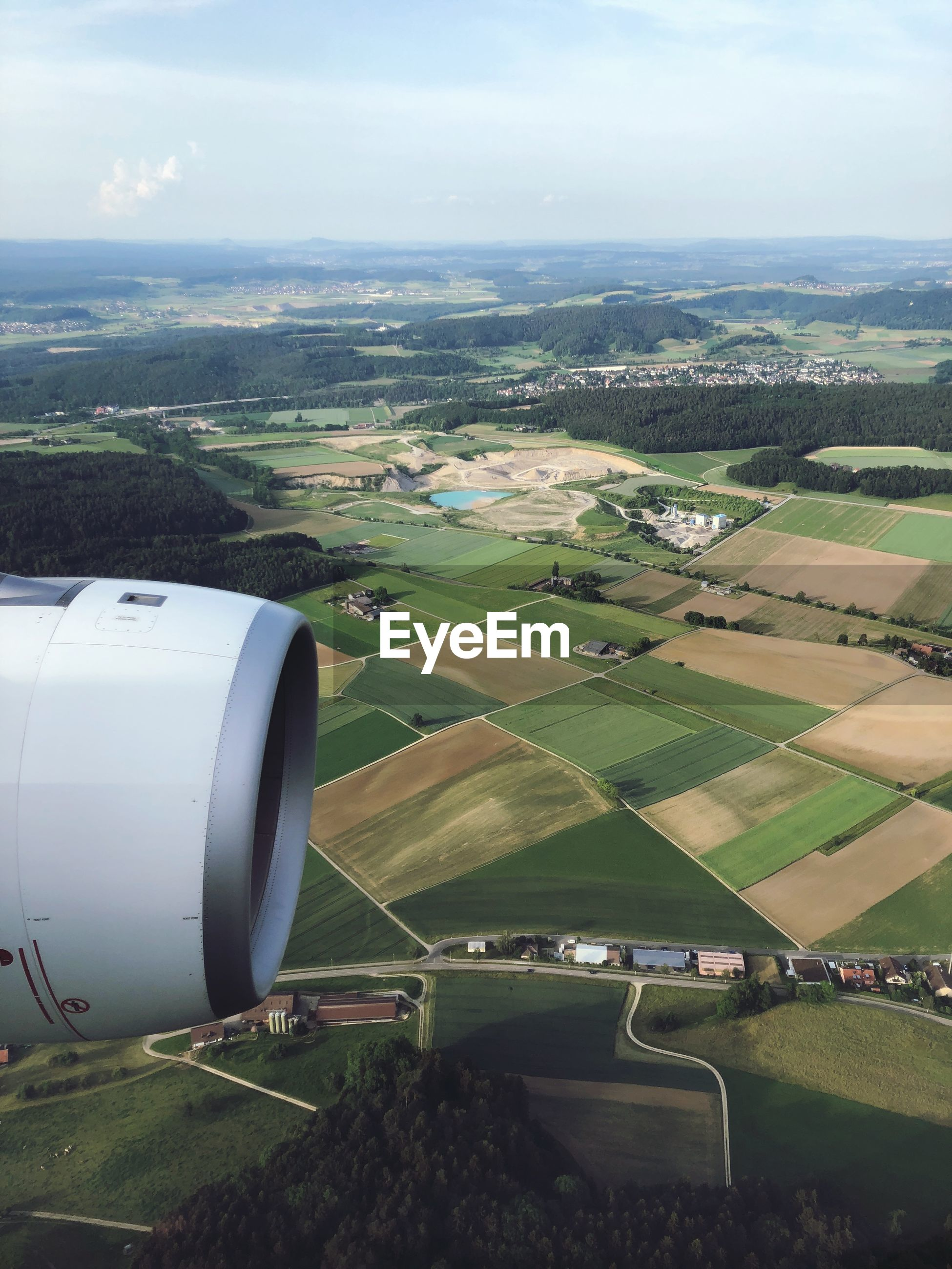 AERIAL VIEW OF LANDSCAPE SEEN THROUGH AIRPLANE