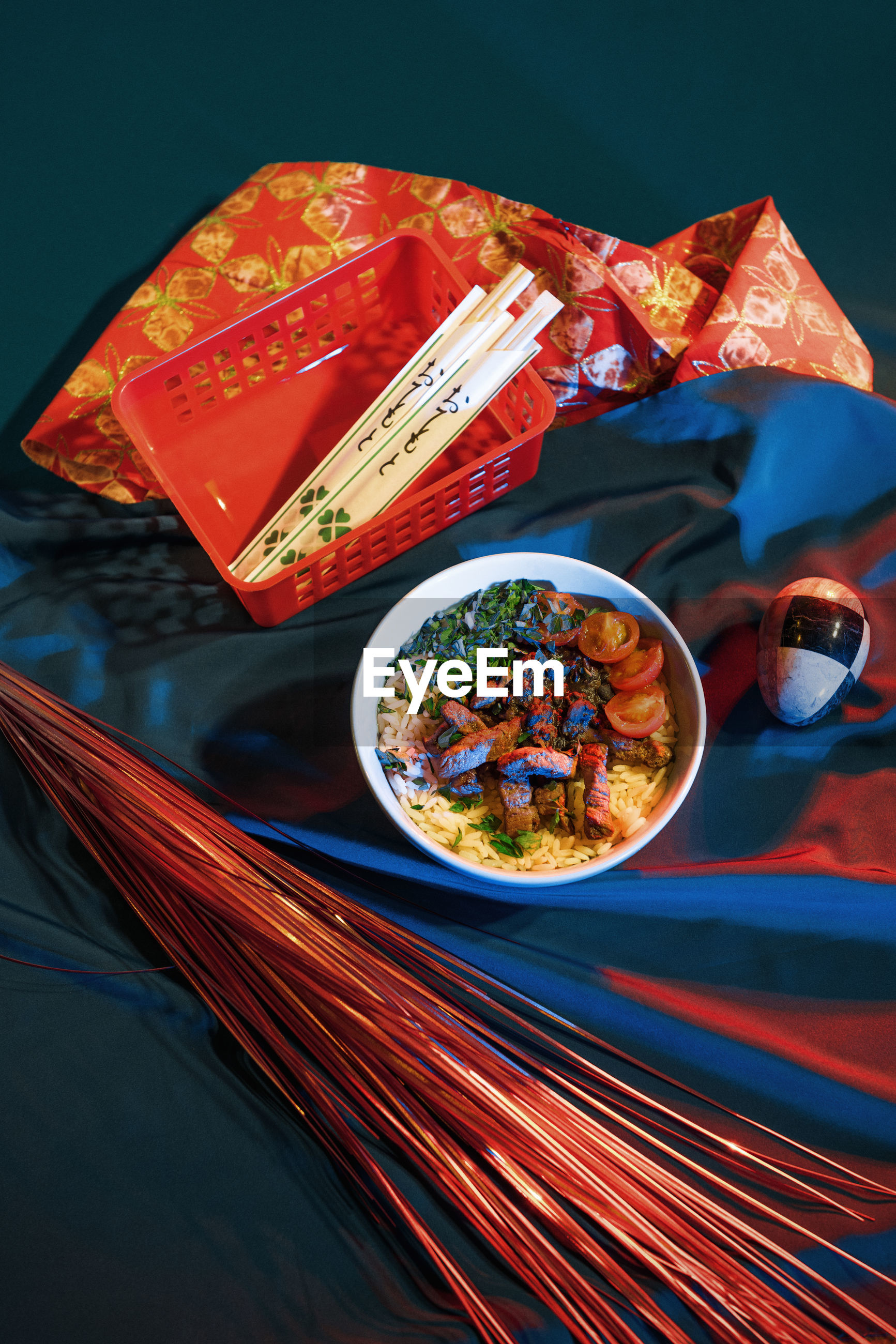 High angle view of food in bowl by fabric and decoration on table