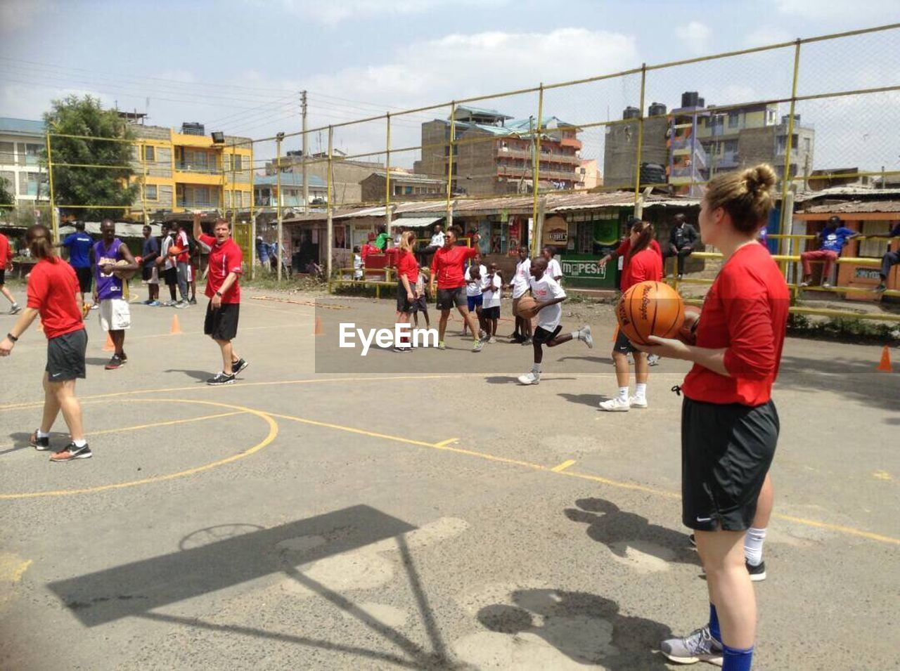 sport, large group of people, playing, practicing, basketball - sport, leisure activity, people, day, court, standing, full length, competition, basketball player, outdoors, togetherness, men, coach, real people, teamwork, adult, sports team, sportsman, sky, athlete, adults only