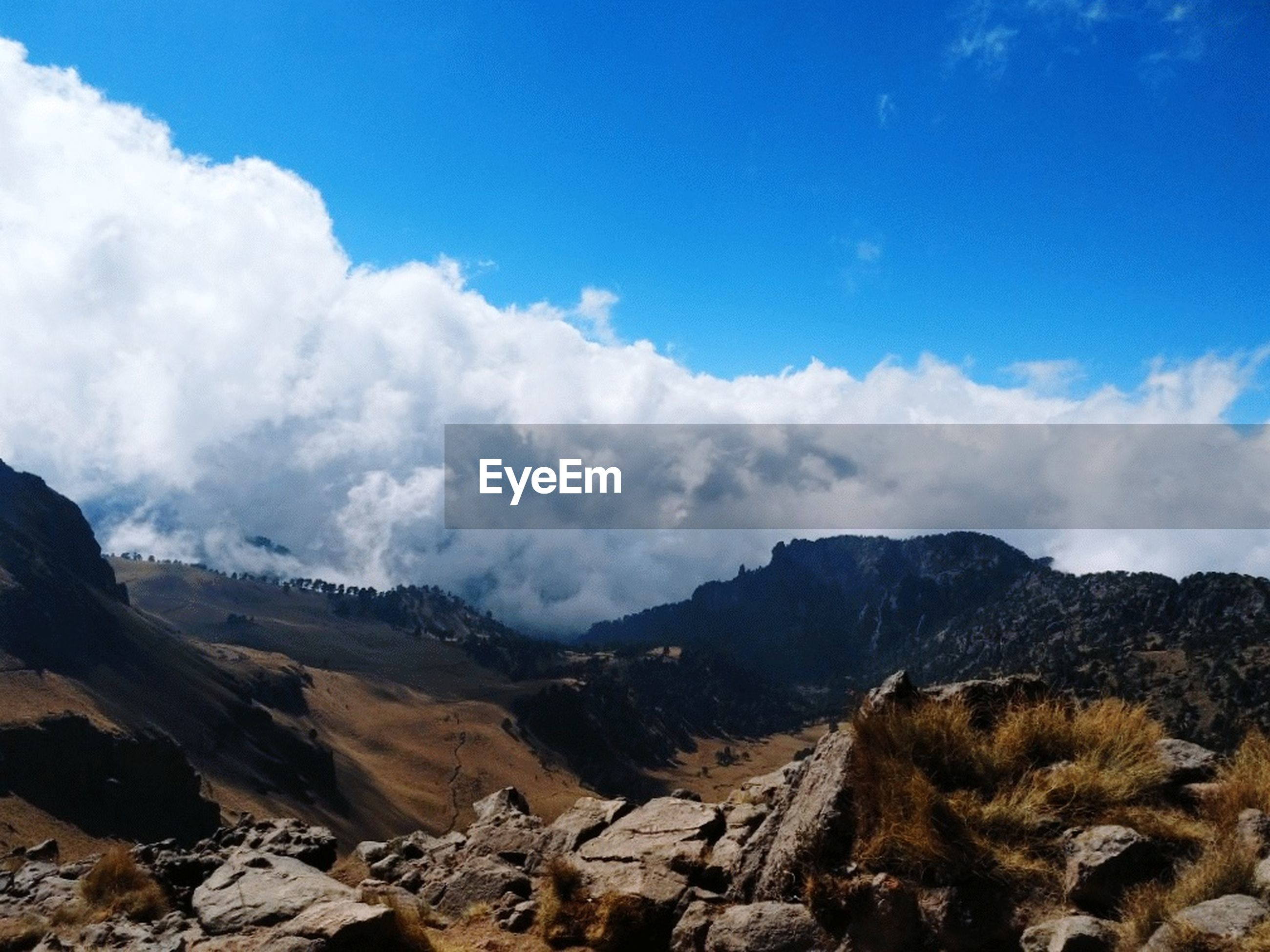 sky, mountain, cloud - sky, scenics - nature, environment, beauty in nature, landscape, nature, mountain range, tranquil scene, tranquility, no people, day, non-urban scene, blue, travel, outdoors, rock, land, travel destinations, formation, mountain peak