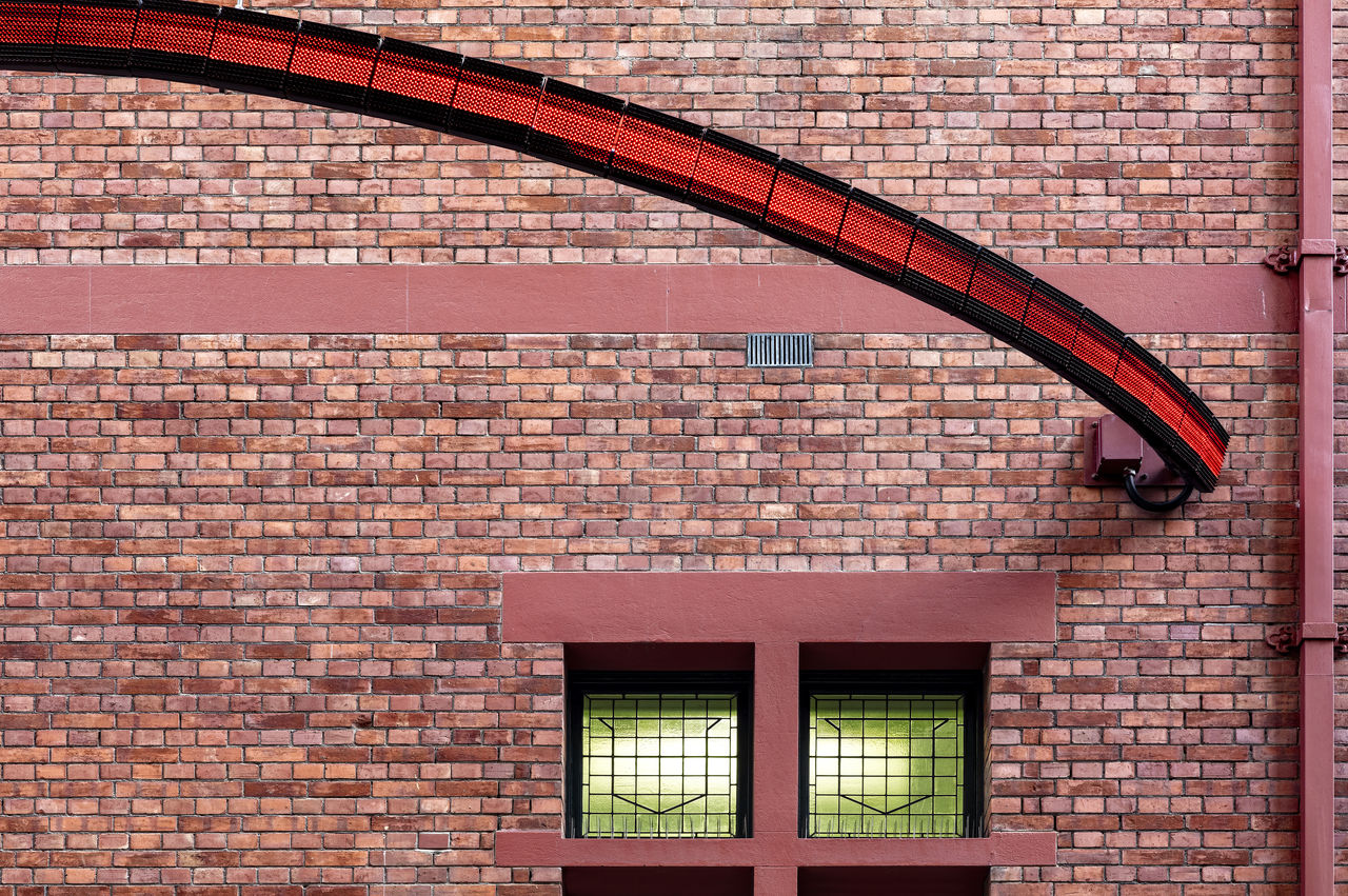 brick, brick wall, architecture, built structure, building exterior, wall, window, red, wall - building feature, no people, day, building, outdoors, lighting equipment, protection, security, low angle view, pattern, safety, residential district, electric lamp