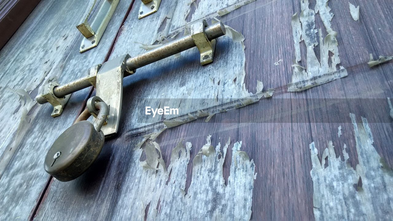 wood - material, door, security, close-up, safety, protection, no people, metal, latch, padlock, lock, day, old-fashioned, indoors, architecture