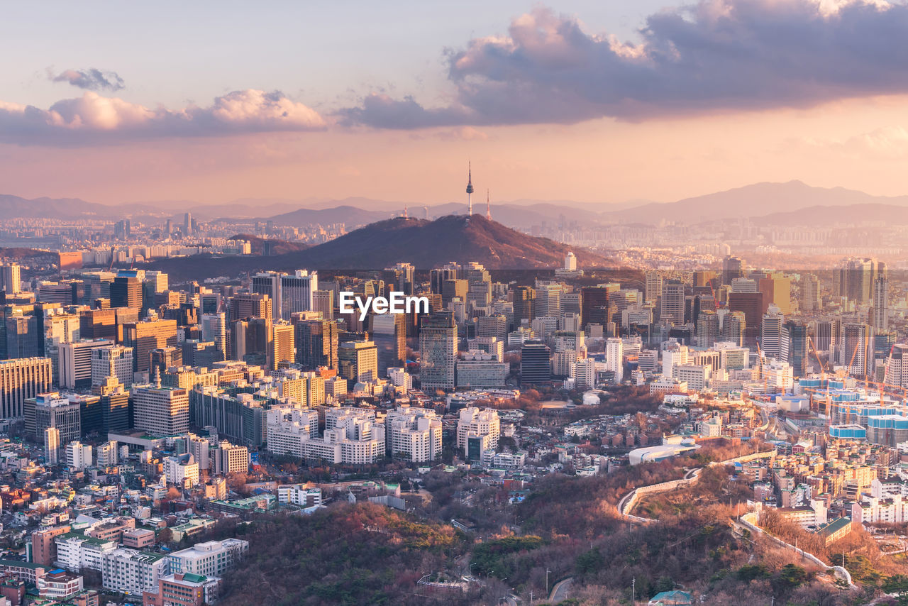 High angle view of namsan - seoul against cloudy sky during sunset