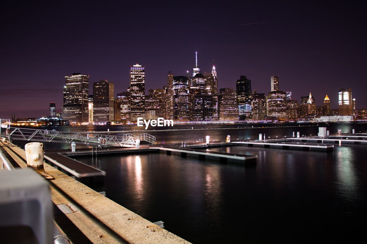 night, illuminated, architecture, built structure, building exterior, skyscraper, city, cityscape, modern, urban skyline, travel destinations, bridge - man made structure, connection, sky, river, waterfront, outdoors, no people, water
