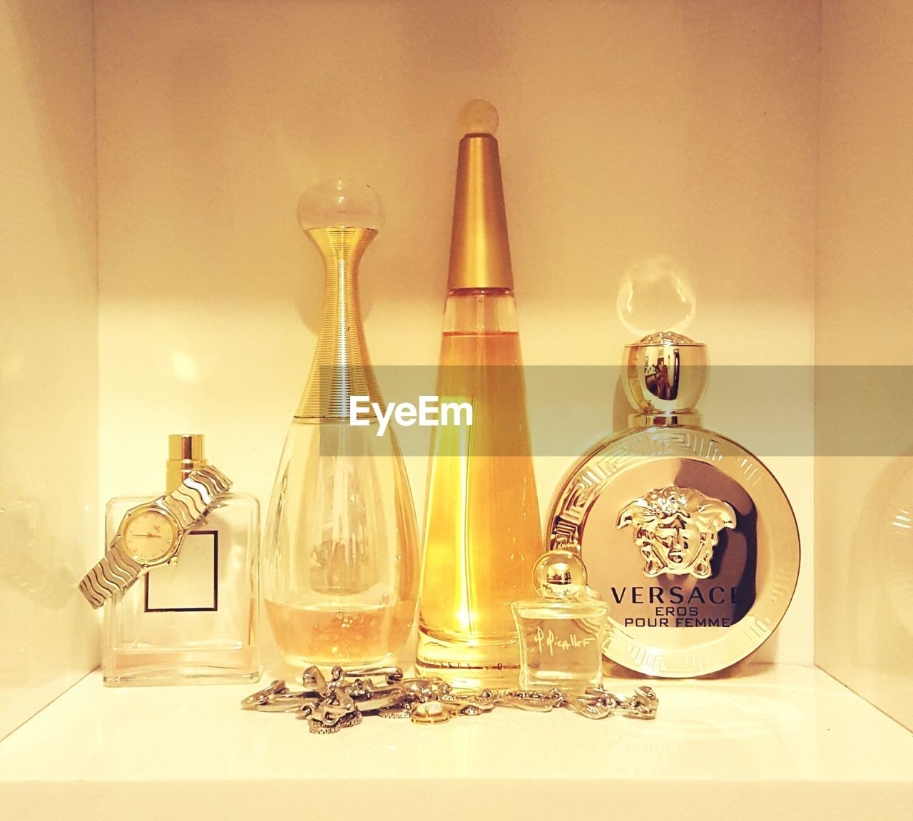indoors, bottle, table, no people, celebration, electricity, perfume sprayer, technology, close-up, christmas decoration, perfume, wineglass, day