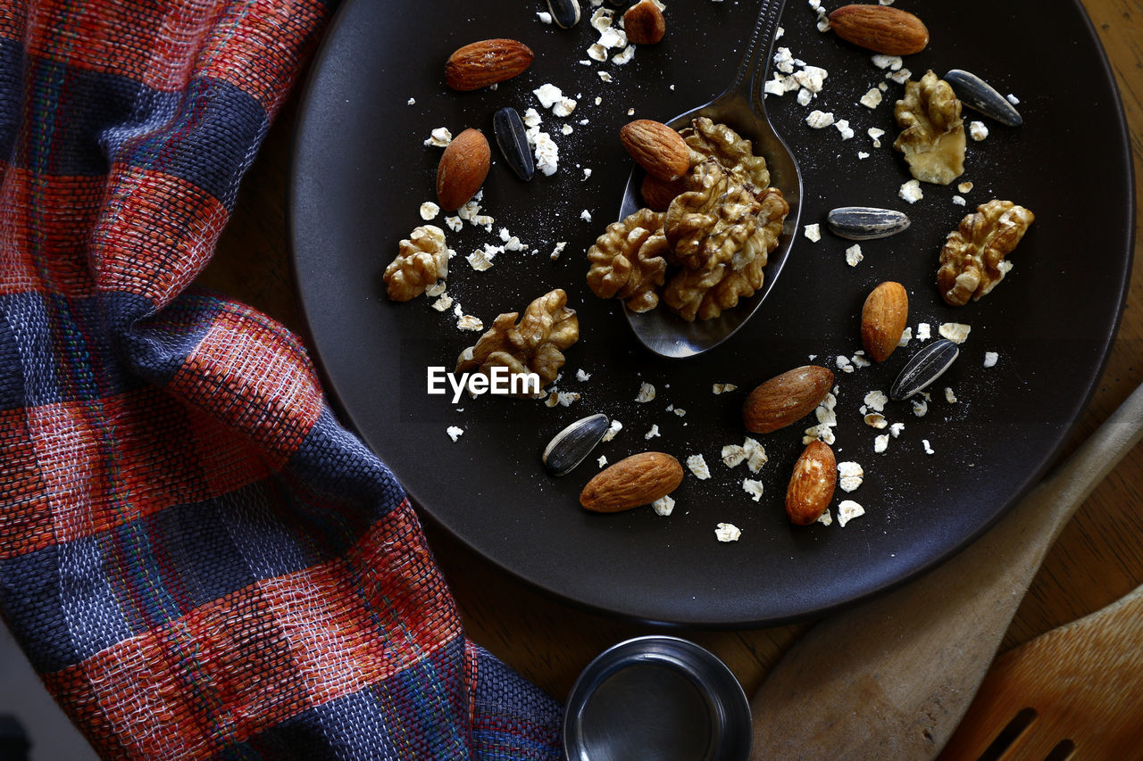 food, food and drink, freshness, nut - food, nut, high angle view, healthy eating, wellbeing, still life, indoors, no people, table, directly above, seed, walnut, close-up, fruit, ready-to-eat, kitchen utensil, eating utensil, temptation