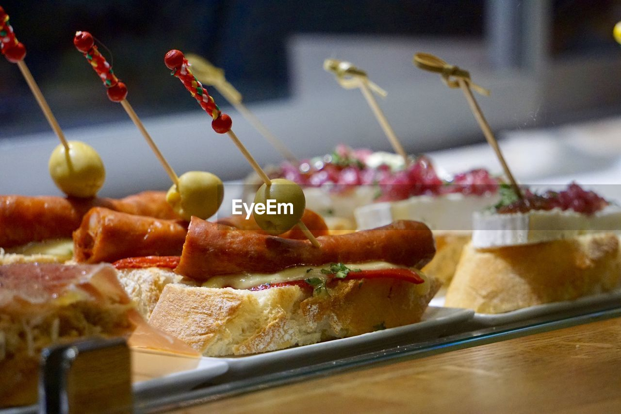 food and drink, food, freshness, no people, ready-to-eat, indoors, bread, focus on foreground, close-up, slice, indulgence, healthy eating, tapas, day