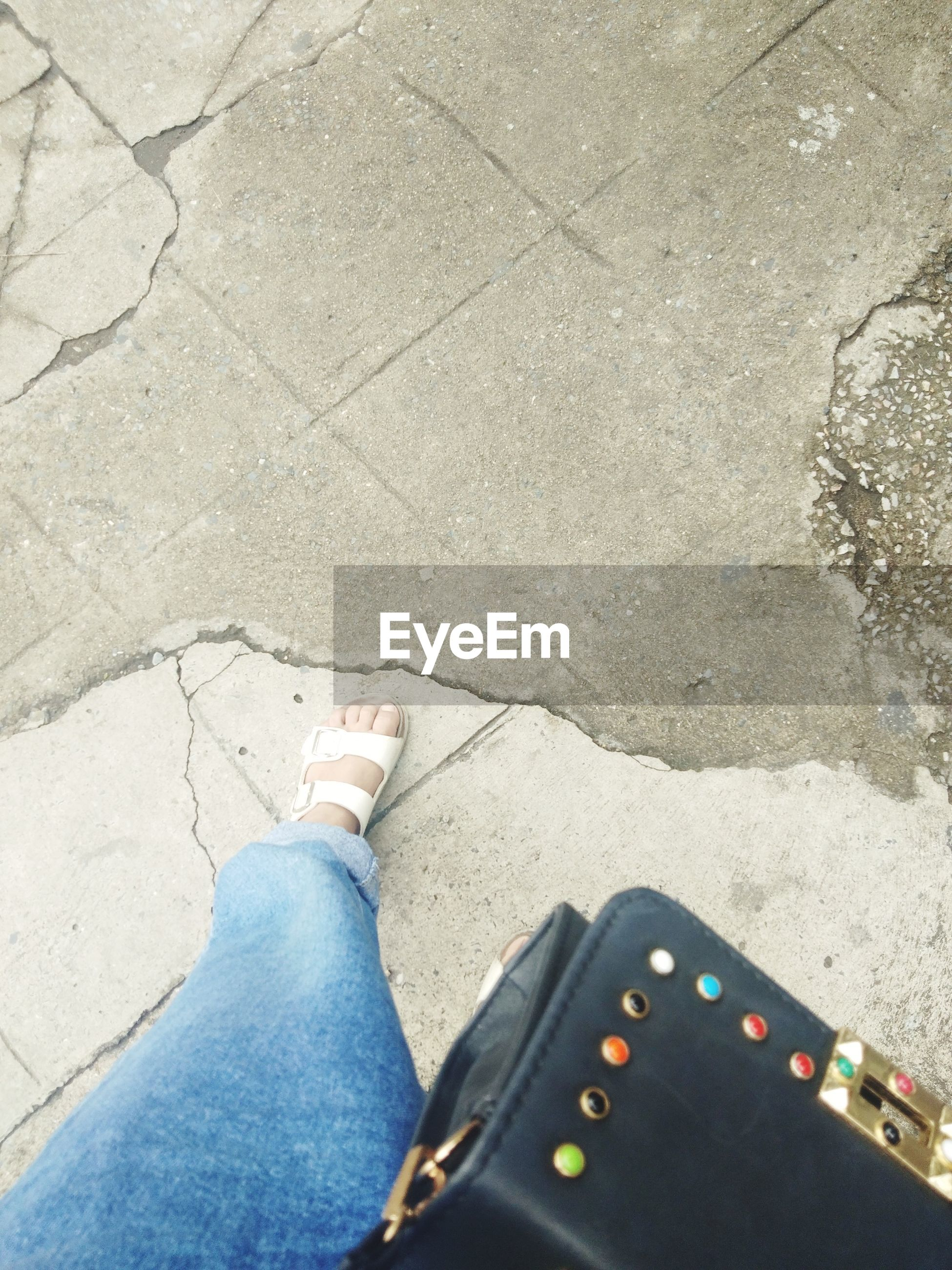 human leg, low section, personal perspective, one person, jeans, human body part, day, directly above, standing, high angle view, shoe, outdoors, real people, close-up, adult, people