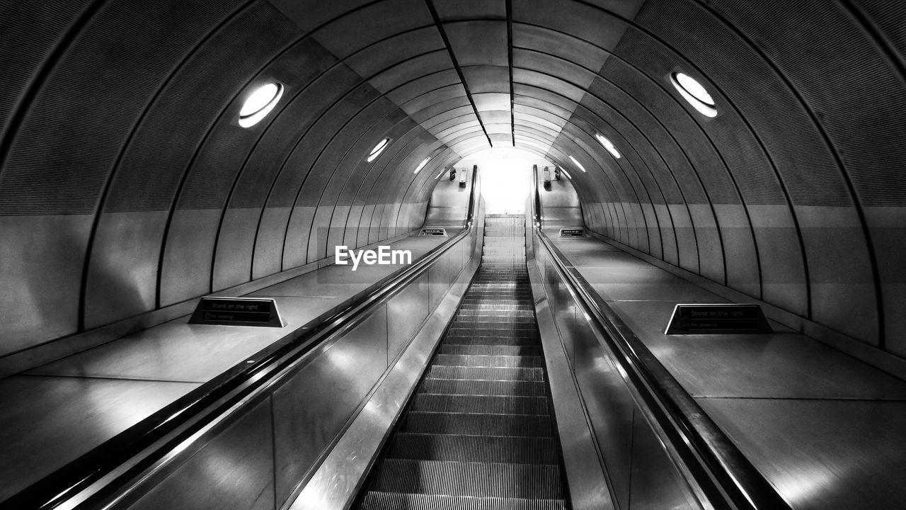 Interior of illuminated escalator