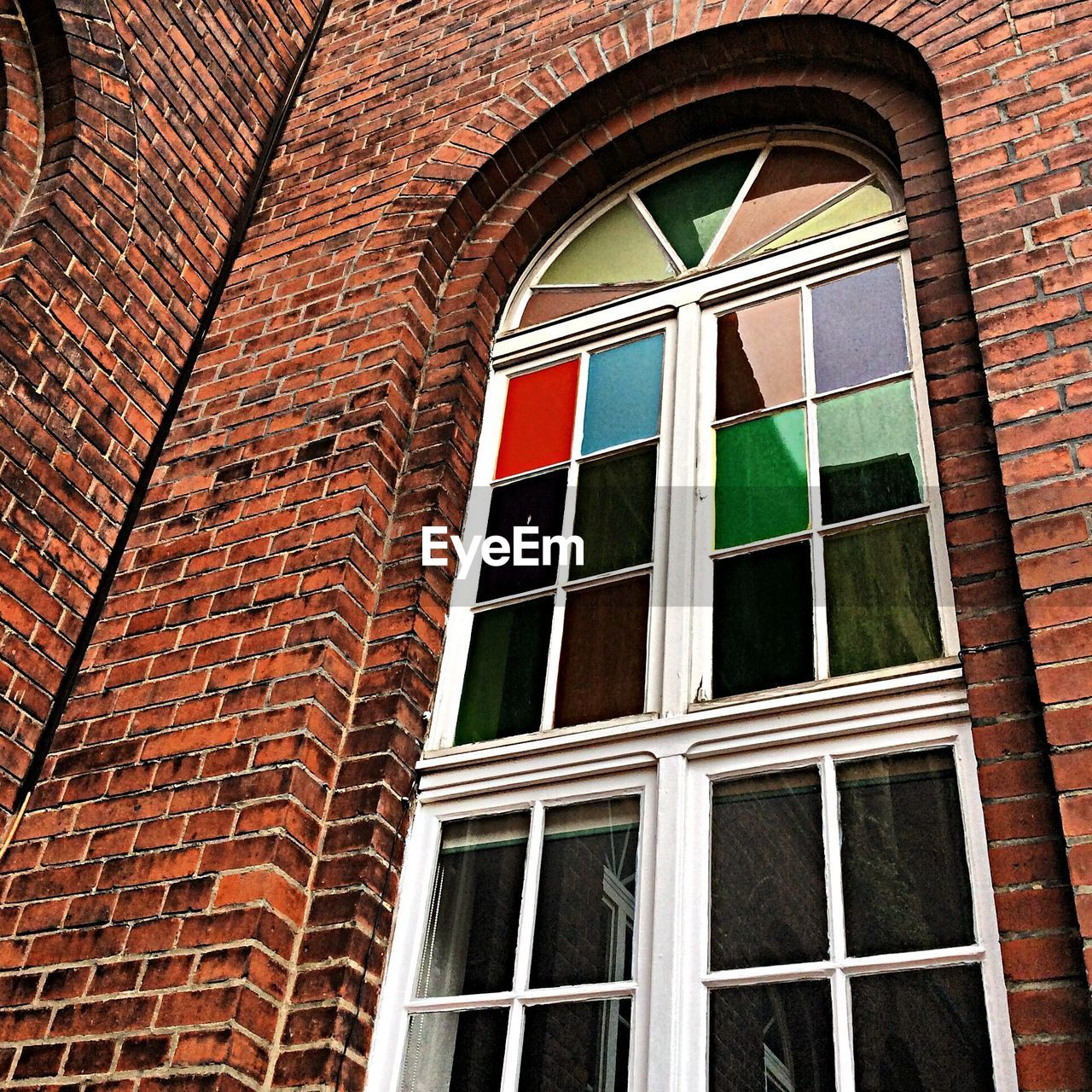 window, building exterior, architecture, low angle view, built structure, brick wall, day, no people, outdoors