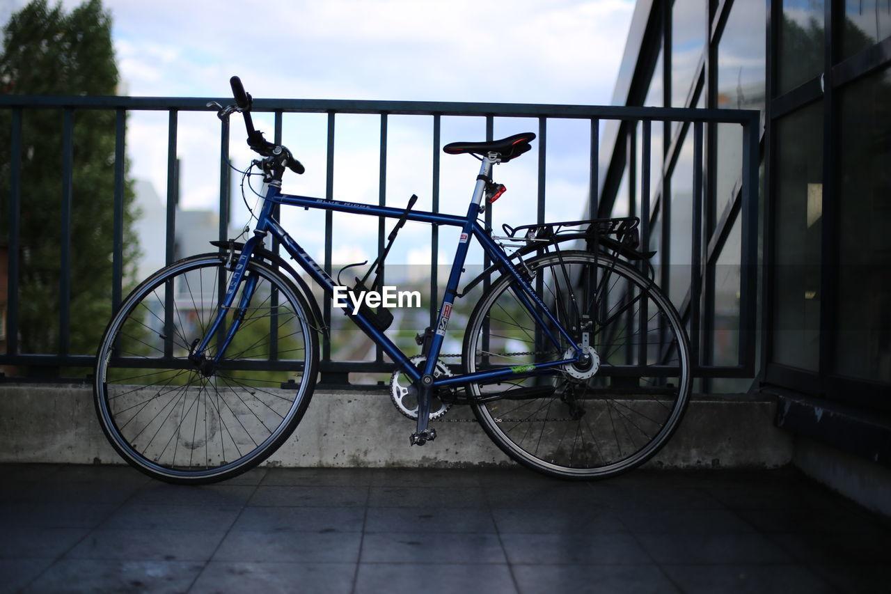 BICYCLE PARKED ON SIDEWALK BY FOOTPATH