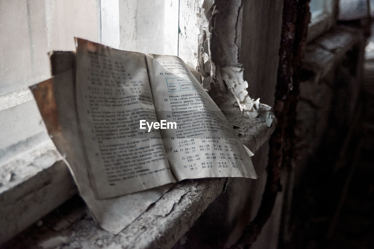 CLOSE-UP OF OLD OPEN BOOK AT HOME