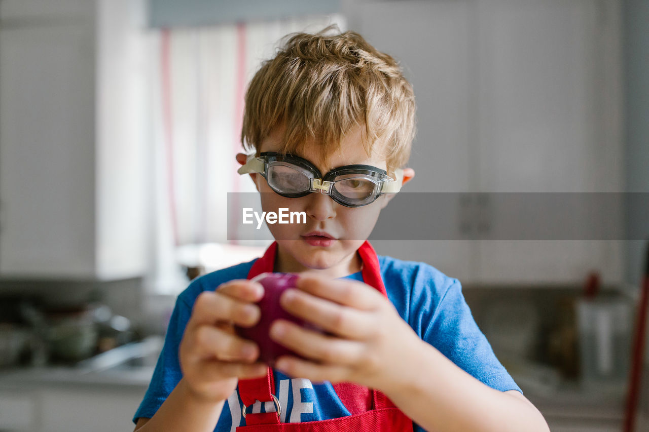 Close-Up Of Boy Wearing Swimming Goggles At Home