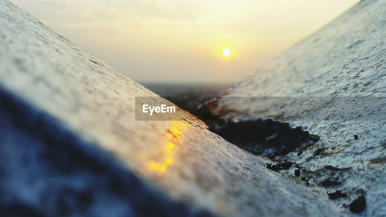 sunset, sun, selective focus, nature, water, no people, outdoors, sea, sky, sunlight, beauty in nature, close-up, scenics, day