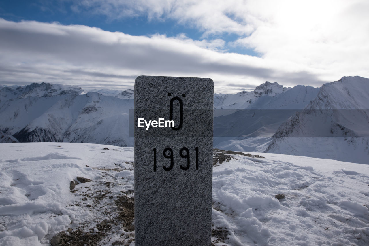 Number On Stone At Snowcapped Mountain At Alps