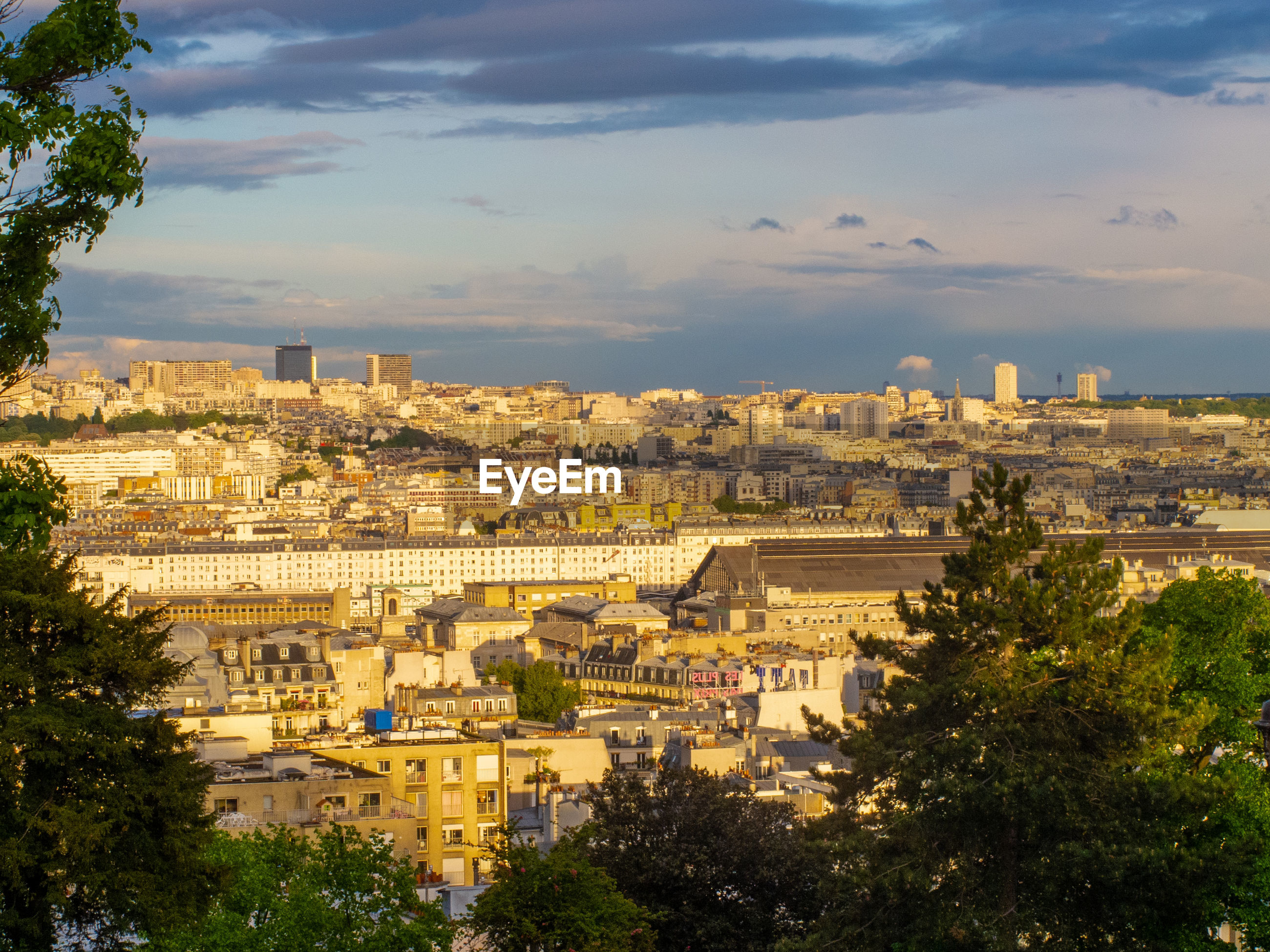 Cityscape of paris with cloudy sky from montmartre, paris, france