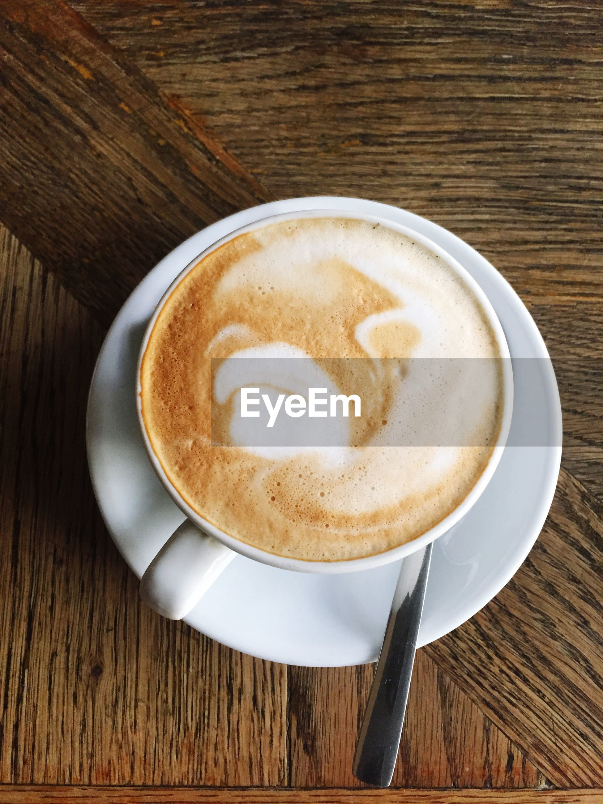food and drink, coffee cup, drink, coffee - drink, refreshment, saucer, table, cappuccino, frothy drink, indoors, froth art, freshness, coffee, still life, spoon, latte, directly above, high angle view, cup, close-up