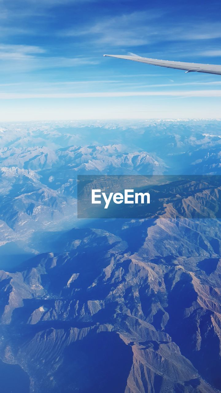 scenics - nature, aerial view, beauty in nature, sky, environment, tranquil scene, cloud - sky, landscape, tranquility, no people, nature, mountain, mountain range, day, idyllic, blue, outdoors, airplane, air vehicle, non-urban scene, snowcapped mountain, climate, view into land