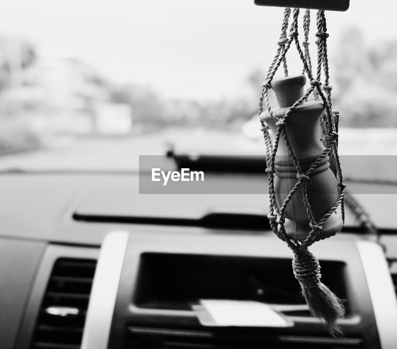 Close-up of decoration hanging in car