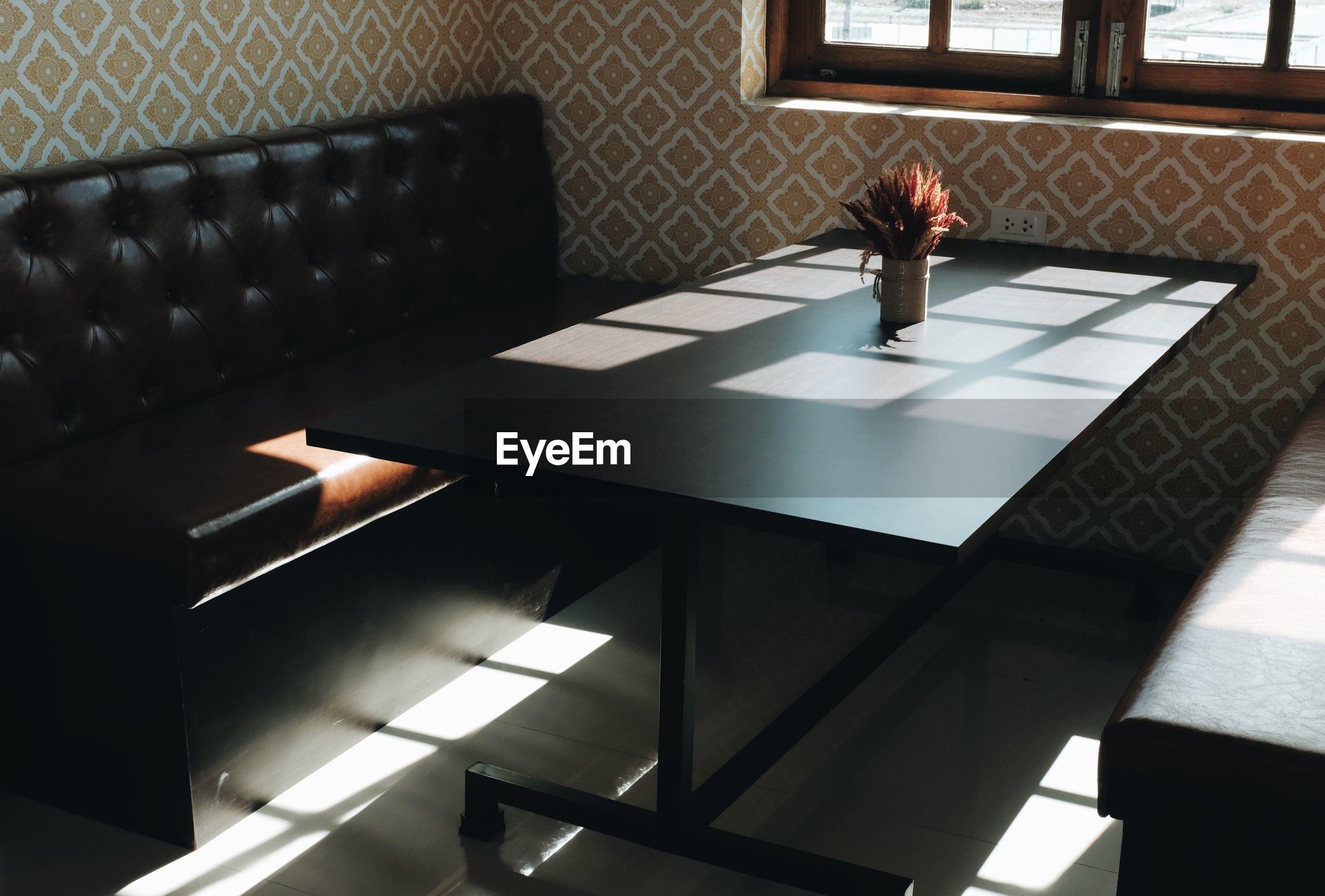 SUNLIGHT FALLING ON TABLE