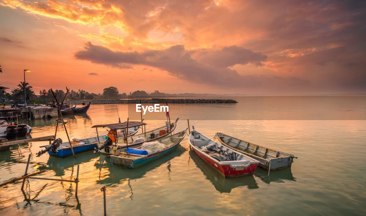 sunset, sky, water, cloud - sky, transportation, nautical vessel, mode of transportation, sea, scenics - nature, moored, orange color, beauty in nature, waterfront, tranquility, reflection, no people, nature, tranquil scene, horizon over water, outdoors, fishing boat