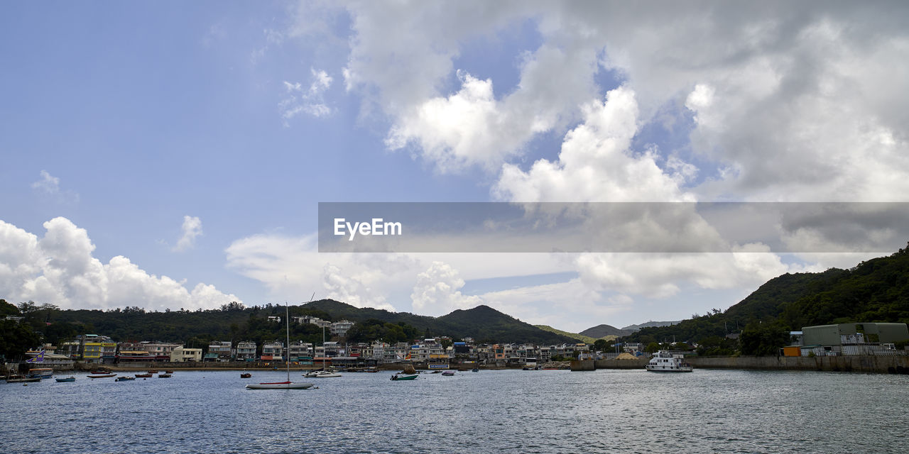 PANORAMIC VIEW OF MARINA AND BUILDINGS AGAINST SKY