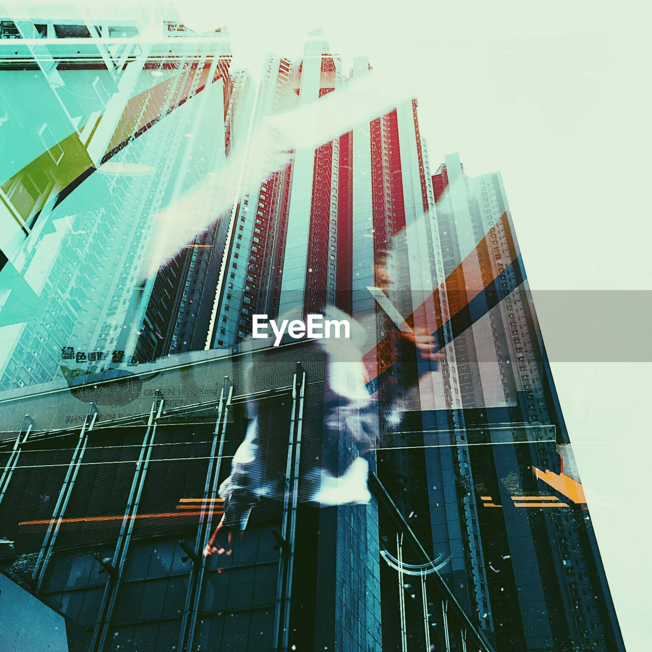 architecture, building exterior, built structure, skyscraper, blurred motion, city, motion, modern, low angle view, outdoors, men, day, teamwork, people