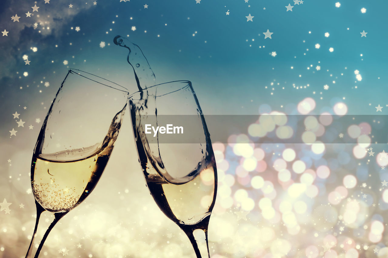 glass, transparent, water, focus on foreground, no people, glass - material, close-up, nature, refreshment, drink, alcohol, wine, food and drink, wineglass, household equipment, sky, lens flare, sunset, reflection, outdoors