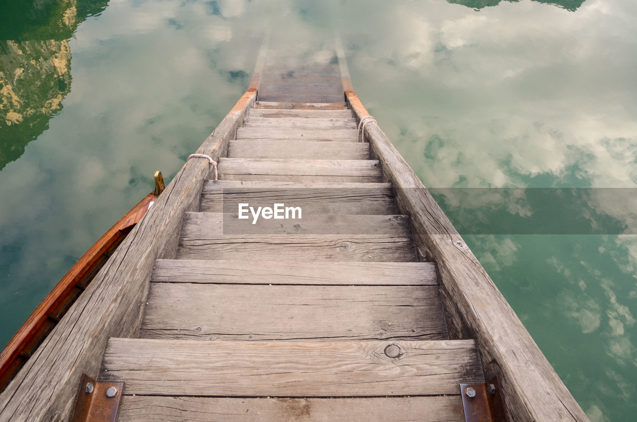 Wooden jetty leading to pier over lake