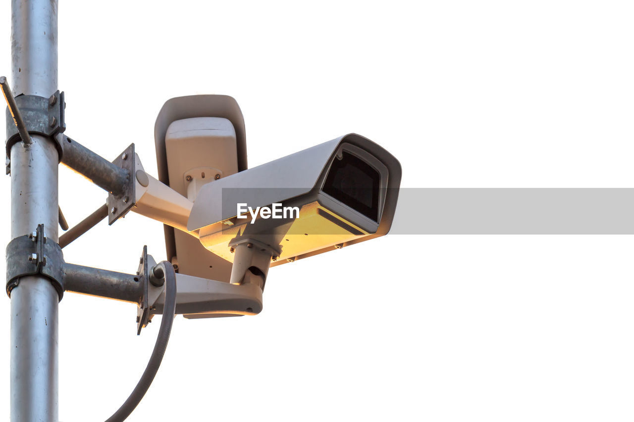 Low angle view of security camera against clear sky