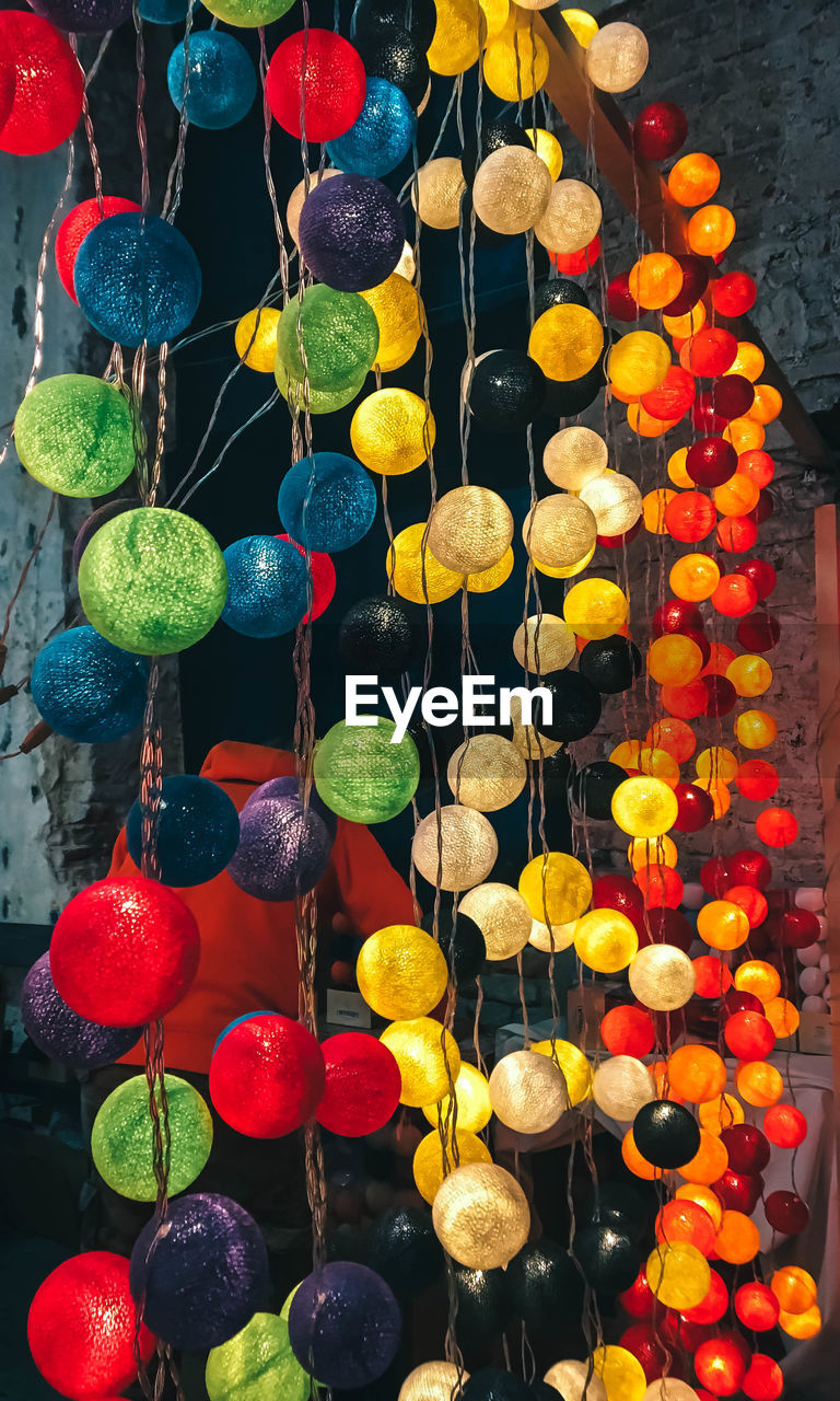 HIGH ANGLE VIEW OF MULTI COLORED DECORATION HANGING FOR SALE