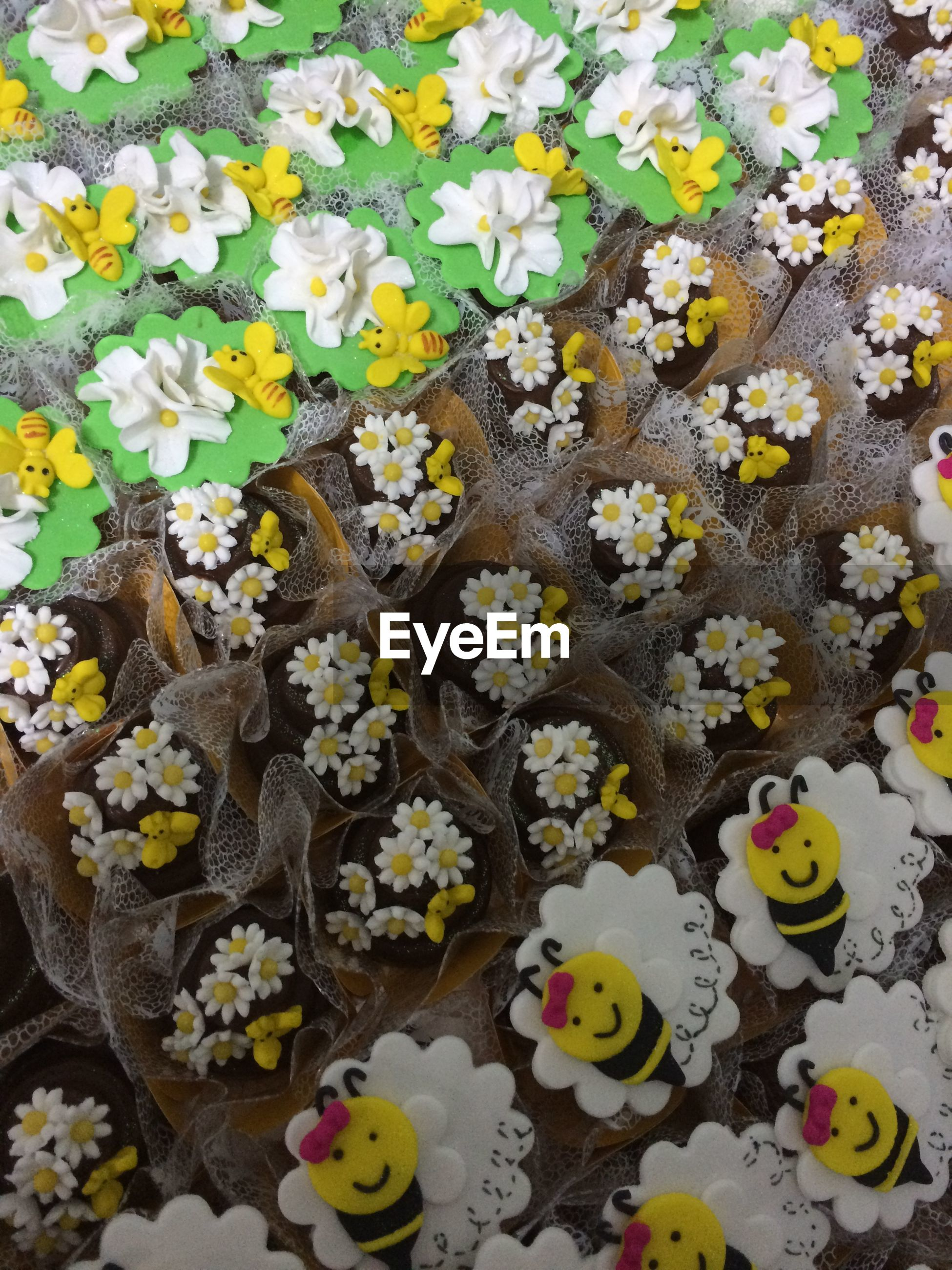 high angle view, multi colored, flower, full frame, abundance, yellow, petal, variation, backgrounds, fragility, leaf, directly above, white color, nature, large group of objects, art and craft, freshness, colorful, day, creativity