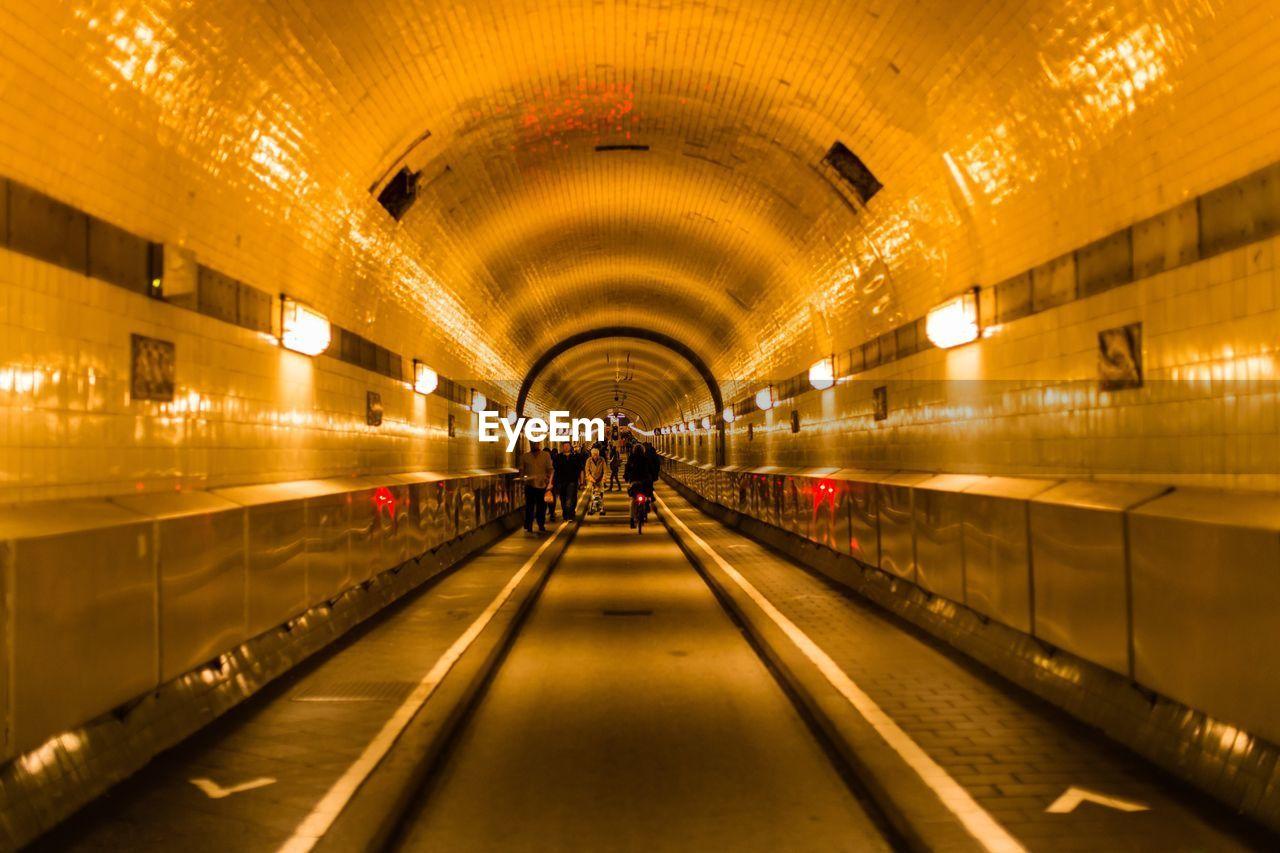 People Walking On Subway Station Road