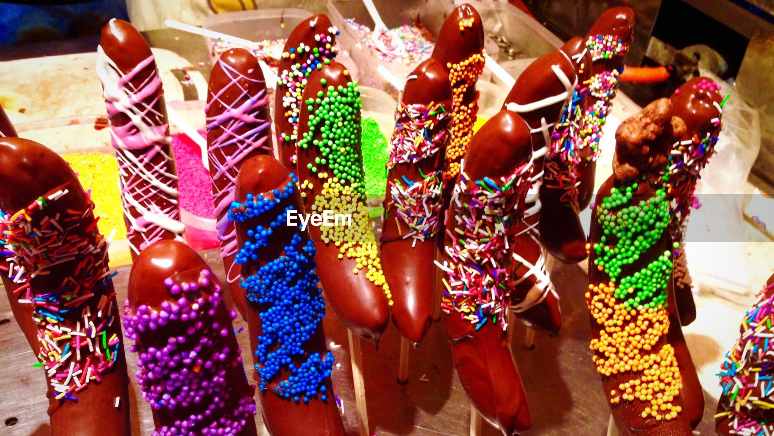 food and drink, freshness, variation, food, choice, for sale, celebration, multi colored, person, abundance, retail, lifestyles, indoors, sweet food, tradition, market stall, leisure activity
