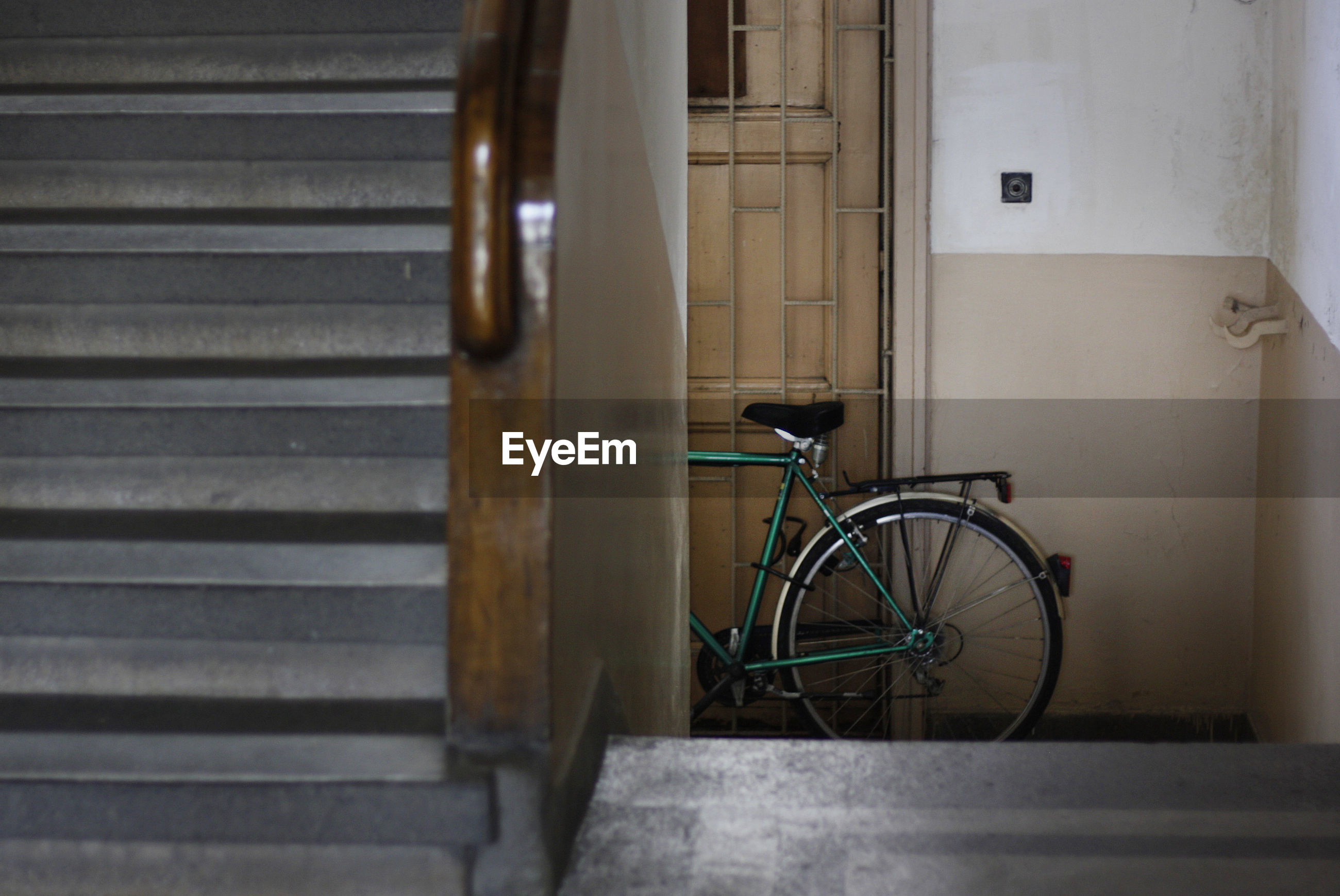 Close-up of steps against bicycle parked by door