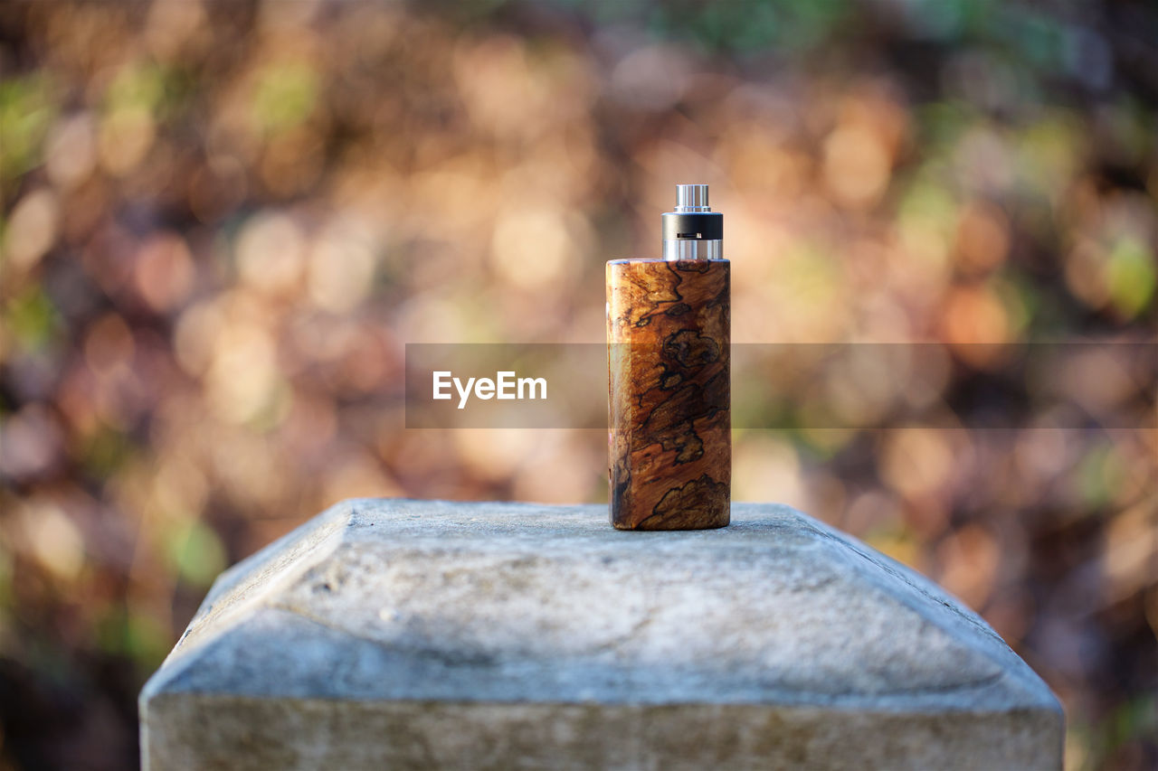 focus on foreground, metal, day, close-up, no people, rusty, smoking issues, post, outdoors, still life, wood - material, selective focus, sunlight, communication, social issues, bolt, nature, sign, cigarette, old, wooden post, nail