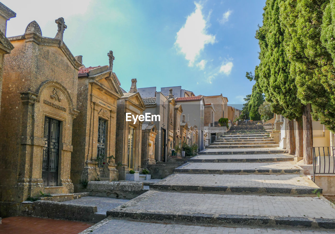 architecture, built structure, building exterior, staircase, sky, no people, tree, nature, day, plant, building, steps and staircases, the way forward, direction, architectural column, history, the past, in a row, outdoors, place of worship