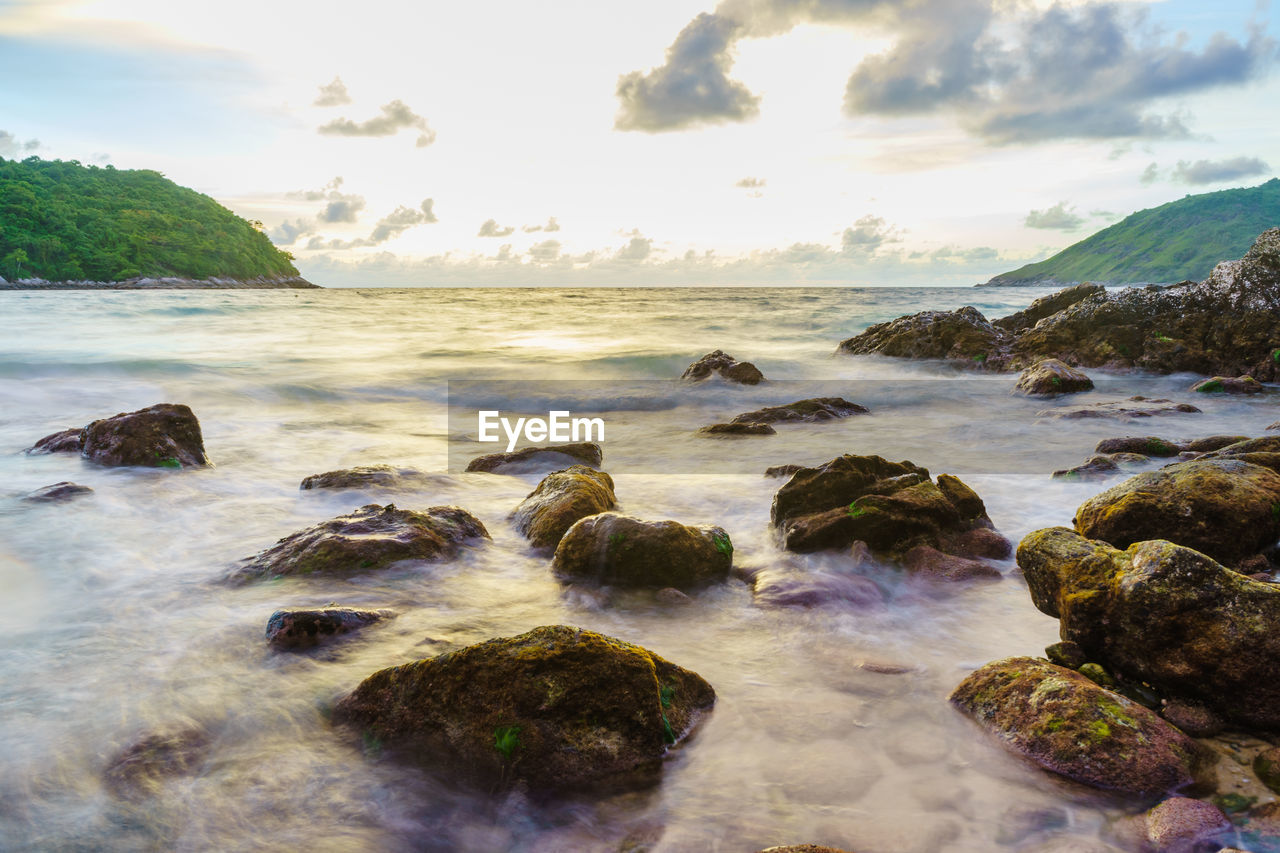 water, sea, rock, sky, solid, rock - object, beauty in nature, scenics - nature, motion, nature, cloud - sky, land, beach, no people, tranquility, tranquil scene, horizon over water, long exposure, horizon, outdoors
