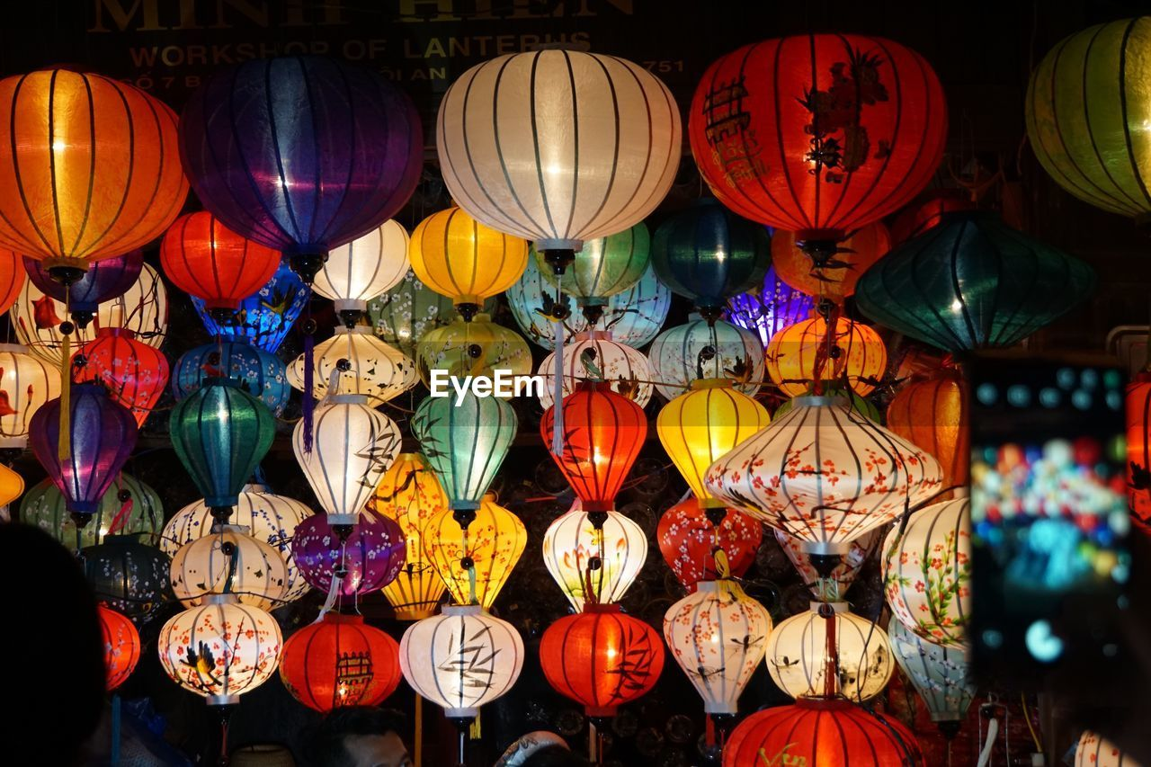lantern, multi colored, lighting equipment, choice, variation, decoration, for sale, illuminated, large group of objects, hanging, abundance, no people, retail, market, night, arrangement, art and craft, celebration, chinese lantern, outdoors, retail display, electric lamp