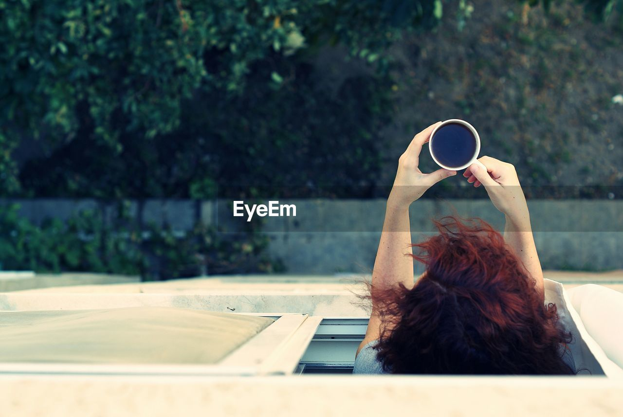 Directly Above View Of Woman Enjoying Black Coffee Looking Through Window